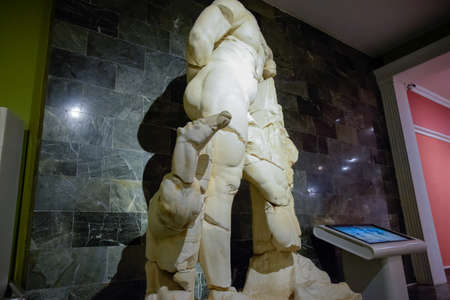Antalya, Turkey - May 20, 2019: The statue of Hercules. Marble statues of gods and emperors of antiquity in the Museum of Antiquities of Antalya, Turkey.
