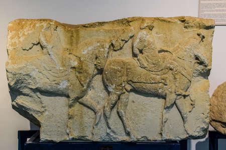 Antalya, Turkey - May 20, 2019: Bas-relief horsemen on horseback, museum exhibit in the museum of antiquities of Antalya.