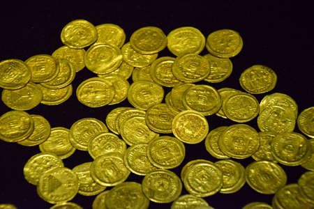 Gold coins in bulk, Antique coins from the city of Perge. Banco de Imagens