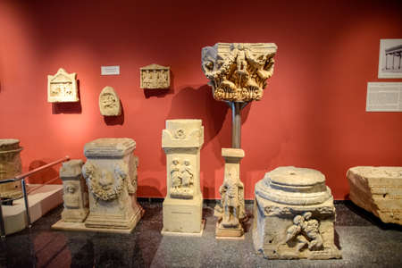 Antalya, Turkey - May 20, 2019: Stands for columns and altars in antique bas-reliefs in the museum of antiqualia antiquities.