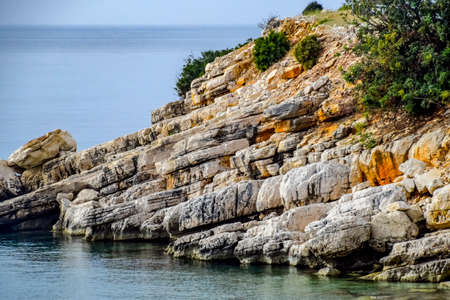 Sedimentary rocks of limestone and white marble on the shores of the Mediterranean Sea