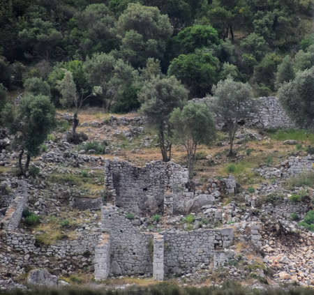Ancient ruins of antique buildings, stone masonry of dilapidated walls.