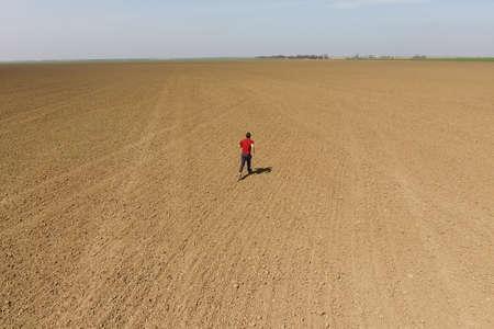 A man runs across the field. Jogging in the open field.