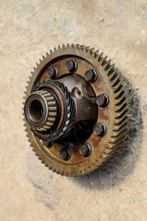 Dismantled box car transmissions. The gears on the shaft of a mechanical transmission. Gear with bearings Stock Photo