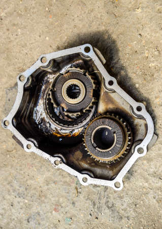 Gear with bearings and gearbox housing. Dismantled box car transmissions. The gears on the shaft of a mechanical transmission