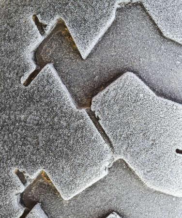 Hoarfrost on a rubber tire wheel. Morning frost.
