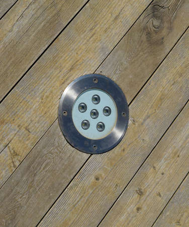 LED outdoor light for illumination, built-in wooden floor. Imagens - 129272830