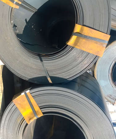Steel sheets rolled up into rolls. Export Steel. Packing of steel for transportation. Stock fotó