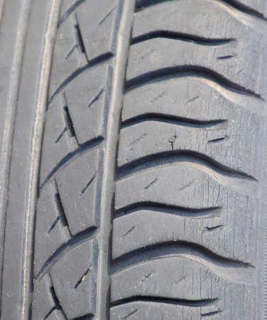 The background of the tread pattern of the car wheel. Rubber tires. Stock Photo