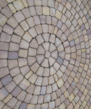 Background texture of paving slabs in circles. Stockfoto