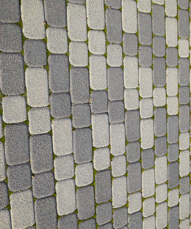 Industrial building background of paving slabs with overgrown with moss in the cracks. Texturing background. Stockfoto - 129488042