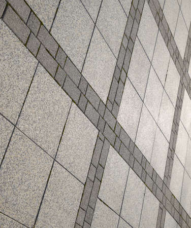 Figure out the paving slabs in the square. Background of paving slabs. Texture of stone products. 免版税图像 - 129488045