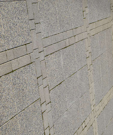 Figure out the paving slabs in the square. Background of paving slabs. Texture of stone products.