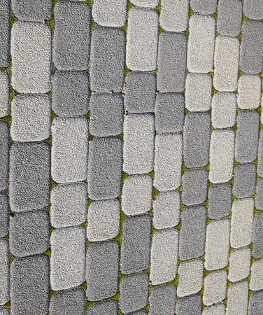 Industrial building background of paving slabs with overgrown with moss in the cracks. Texturing background. Stockfoto - 129487608