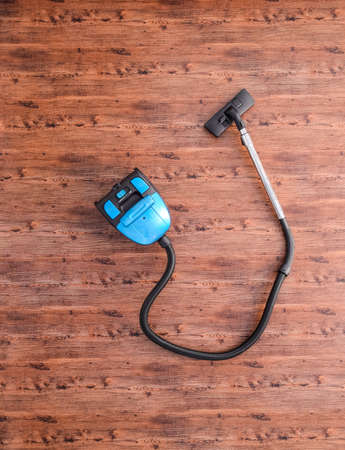Vacuum cleaner on the floor in the room, top view. Stock Photo