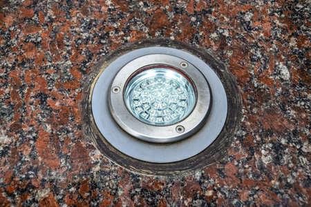 LED backlight in granite stone. Light fixture.