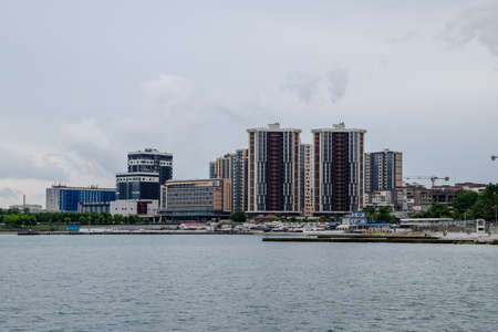 Residential multi-storey buildings on the seashore. City Novorossiysk embankment of Admiral Serebryakov. 版權商用圖片