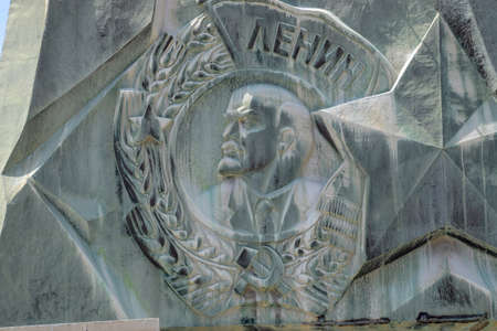 Novorossiysk, Russia - May 20, 2018: Coat of arms with a bas-relief of Lenin on the monument. The leader of the revolution.