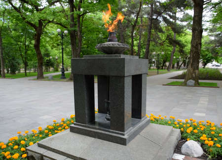 The monument is the eternal flame, in memory of the fallen soldiers in the second world war. Stock Photo