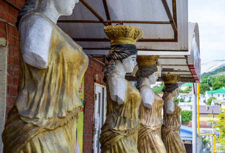 Novorossiysk, Russia - May 20, 2018: Statues of women without hands in the form of an aphrodite as supports for a canopy.