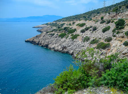 The coast of the Mediterranean Sea. The shore is composed of limestone and marble. Stock fotó