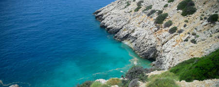 The coast of the Mediterranean Sea. The shore is composed of limestone and marble.