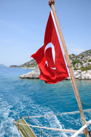 Turkey flag at the stern of a pleasure yacht. View of the Mediterranean coast