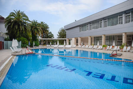 Demre, Turkey - May 21, 2019: Pam Thermal Hotel, Hot spring mineral medicinal water. Pam Hotel, view from the courtyard. Pool and restaurant tables. Thermal balneotherapy, hotel Éditoriale