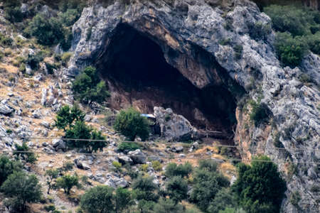 Caves in the limestone mountains. Void in the rock mountain. Stock Photo