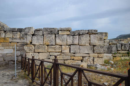 The walls of the ancient ruins of limestone blocks. Ruins of the city of Hierapolis, Turkey. Фото со стока
