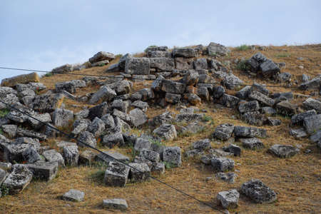Huge blocks of a wall destroyed by an earthquake. Ruins of the city of Hierapolis, Turkey. Фото со стока