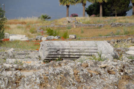 Elements of antique ruins of limestone blocks. The destroyed columns. Ruins of the city of Hierapolis