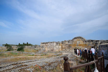 Hierapolis, Turkey - May 22, 2019: The walls of the ancient ruins of limestone blocks. Ruins of the city of Hierapolis, Turkey.