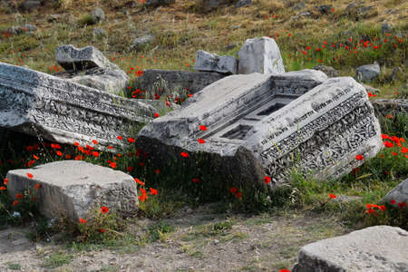 Fragments of ancient buildings, the ruins of the ancient city of Hierapolis. Stone blocks with traces of stone machining. Stock fotó