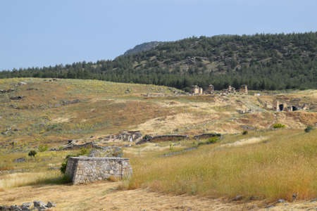 Antique ruins and limestone blocks in Hierapolis, Turkey. Ancient antique city.