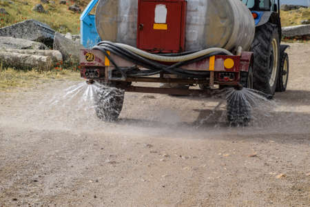 Machine for moistening dust on the road.