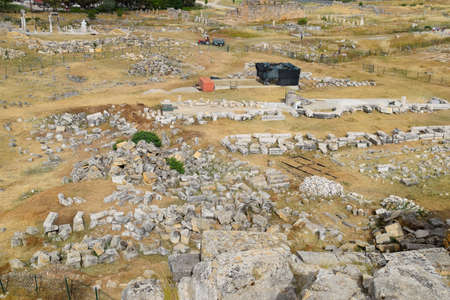 Top view of the excavation site in the ruined ancient city of Hierapolis. The remains of destroyed buildings and columns.