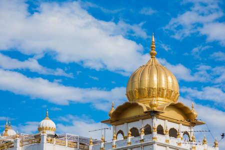 Dome of Gurudwara Siri Guru Singh Sabha seen behind shophouses. The Sikh temple is a landmark of Phahurat neighborhood.