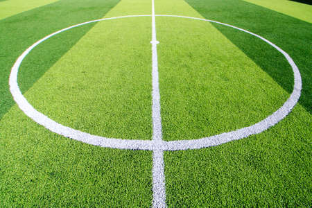 The white Line marking on the artificial green grass soccer field Stock Photo - 82081365