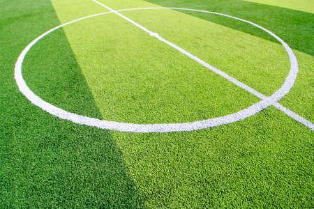 The white Line marking on the artificial green grass soccer field Zdjęcie Seryjne