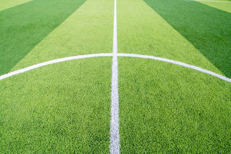 The white Line marking on the artificial green grass soccer field Reklamní fotografie