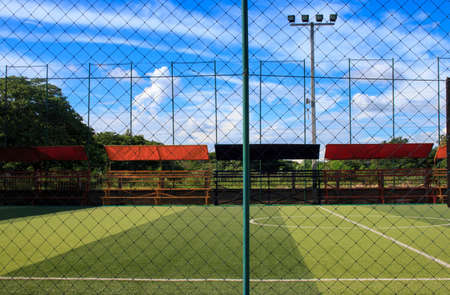 Viewed from behind the cage of football field in the Thailand country Stock Photo