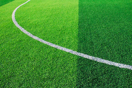 Photo of a green synthetic grass sports field with white line shot from above Stock Photo