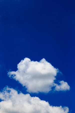 Bright blue sky with white clouds Stock Photo