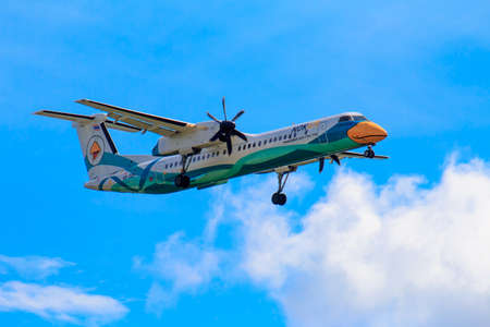Chiang Mai, Thailand - August 27, 2017: Passenger airliner flight in the blue sky
