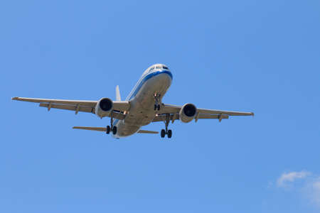 Passenger Airplane Taking Off Into The Blue Sky