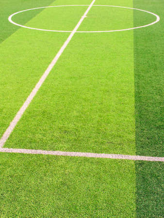 The white Line marking on the artificial green grass soccer field Imagens