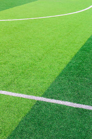 The white Line marking on the artificial green grass soccer field 版權商用圖片