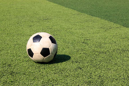 Football on artificial turf. It is for green background in a stadium