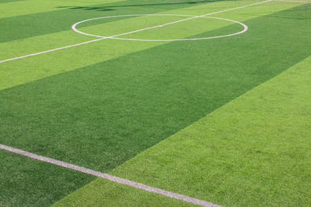 The white Line marking on the artificial green grass soccer field Stock Photo